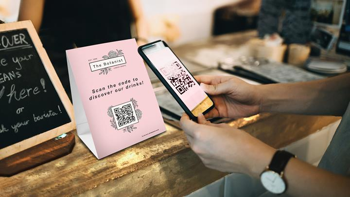 Customer Scanning QR Code, Making A Quick And Easy Contactless Payment With Her Smartphone In A Cafe 1177644574 2125X1417 Focused